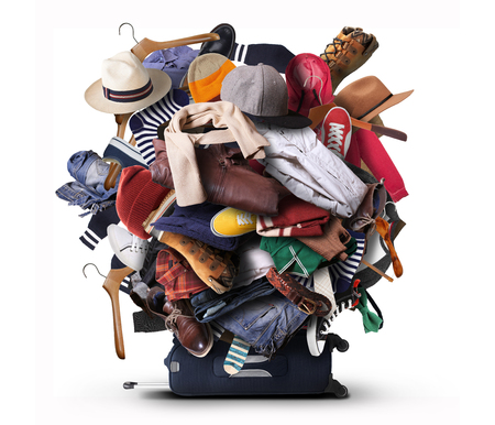 Big heap of different clothes and shoes Stock Photo