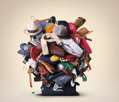 Big heap of different clothes and shoes Stockfoto