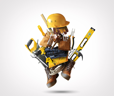 Construction tools with a shoes and a helmet Stock Photo