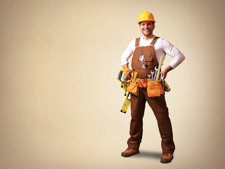funny guys: Builder in yellow helmet, protective glasses and working clothes