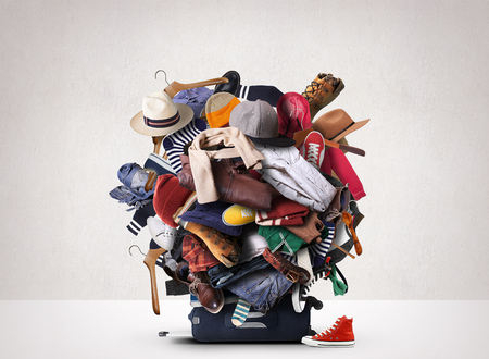 Big heap of different clothes and shoes Imagens