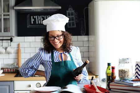 Beautiful woman preparing food in the kitchen