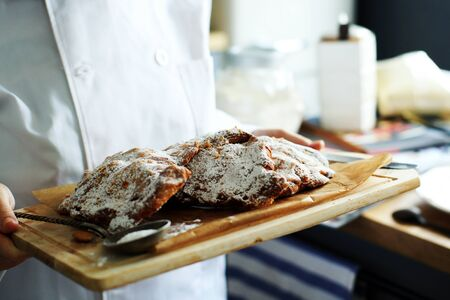 Almond croissants on a tray in a kitchen Stock Photo