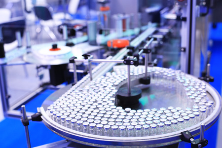 Factory for the production of medicines, glass bottles on the conveyor 스톡 콘텐츠