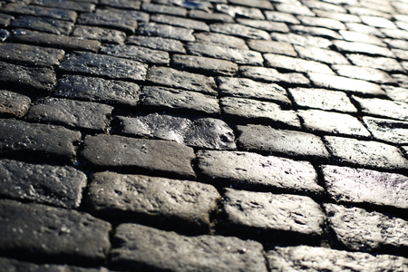 Texture of stone pavement tiles bricks cobblestones background Imagens