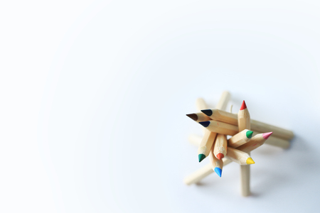 Wooden color pencils stacked in a pile