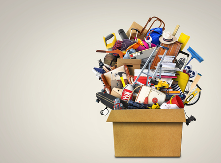 Large pile of household items in a box
