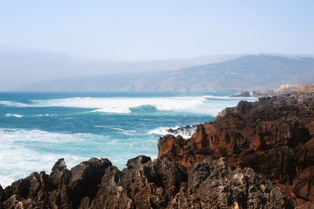 Rocky coast of the Atlantic ocean in Portugal Stock Photo