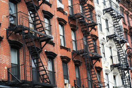 Facades of the buildings in the new York city with cast-iron staircases Stockfoto