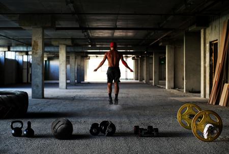 Athlete is engaged in crossfit in brutal gym 写真素材