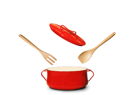 Big red pot for soup with fork and spoon Stockfoto - 110231515