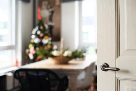 Open door to room with Christmas tree