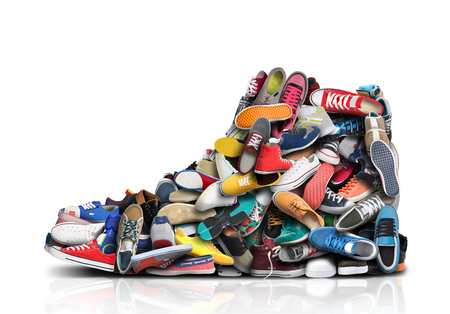 Large sneaker made up of small sneakers and shoes Reklamní fotografie - 114280262