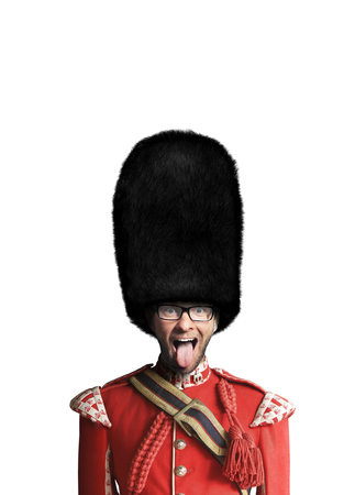 Young man in the costume of the Royal guards of Britain Foto de archivo - 117291554