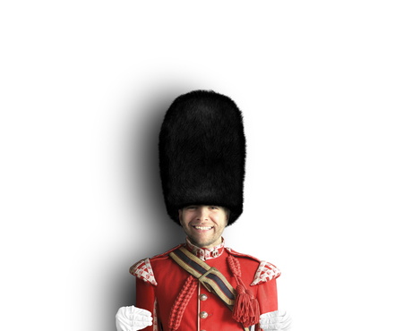 Young man in the costume of the Royal guards of Britain Foto de archivo - 117291736