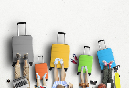 Five colored suitcases for holidays