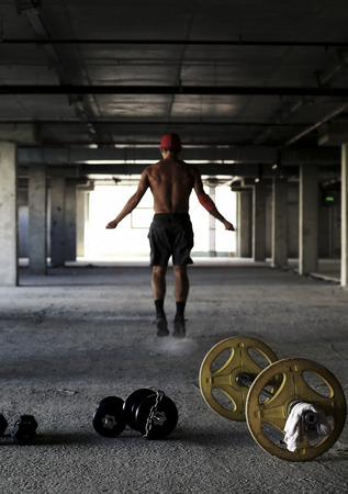 Athlete is engaged in crossfit in the gym Reklamní fotografie