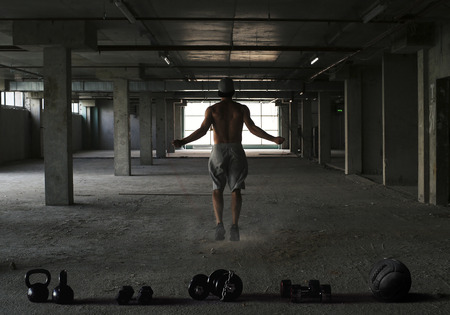 Athlete is engaged in crossfit in the gym Banco de Imagens