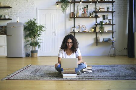 Beautiful woman freelancer working on the laptop at home