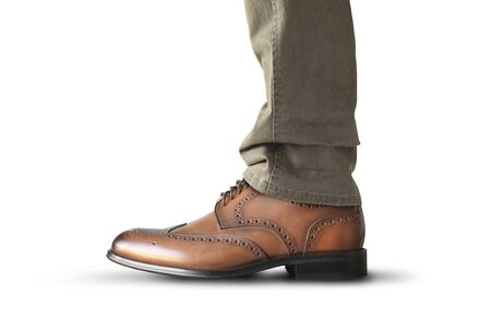 A man stands in brown classic leather men's shoes Archivio Fotografico