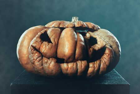 Scary old Halloween pumpkin on dark background Banque d'images