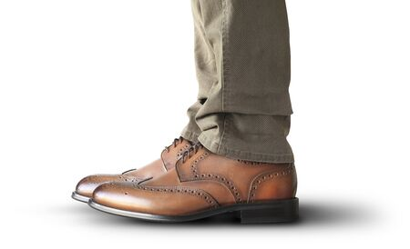 Man is standing in classic leather shoes