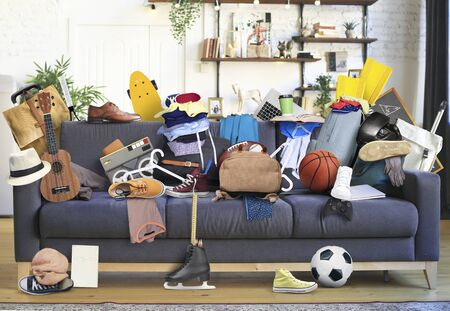 Large leather sofa with a bunch of different things Stock fotó
