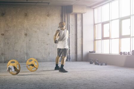 Athlete is engaged in crossfit in the gym Stock Photo