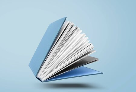 Large hardcover book with open pages