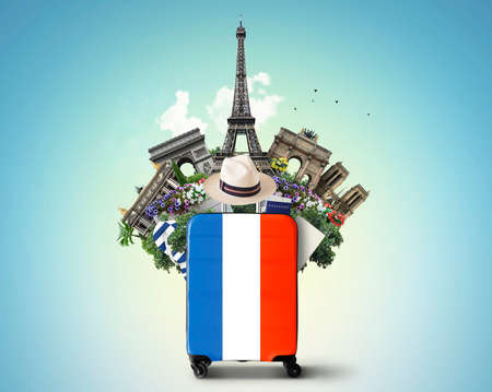 France, modern suitcase with French flag and landmarks Standard-Bild