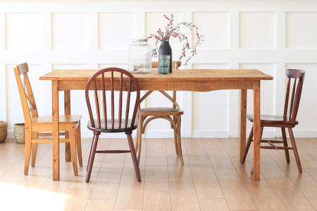 Large wooden table with chairs in the dining room. Standard-Bild