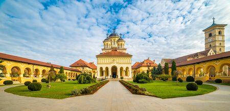 The Coronation Orthodox Cathedral and Saint Michael Roman Catholic Cathedral in Fortress Of Alba Iulia, Transylvania, Romania.