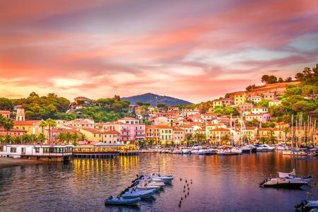 livorno: Harbor and village  Porto Azzurro at sunset, Elba islands, Tuscany, Italy.
