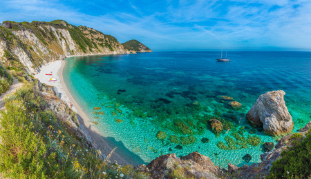 chairs: Sansone beach with amazing turquoise water, Elba Island, Tuscany, Italy.