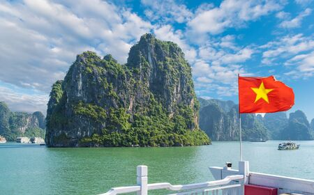 Landscape with Halong bay and Vietnamese flag, Vietnam