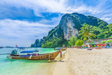 Tonsai Beach bay with traditional longtail boats parking in Phi Phi island, Krabi Province, Andaman Sea, Thailand