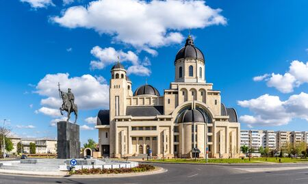 The statue of Stefan Cel Mare and Cathedral in center of Bacau city, Moldavia landmark, Romania