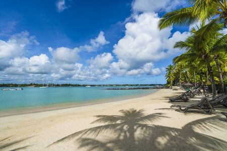 Public beach at Grand baie village on Mauritius island, Africa Stock Photo