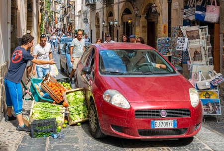 Cefalu, Sicily - September  24, 2018: Car accident on narrow street in Sicily island, Italy Redactioneel