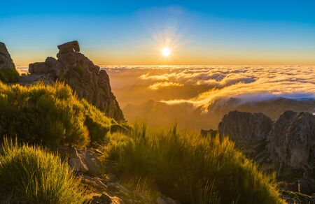 Top of the mountain at sunrise on Pico do Arieiro and Pico Ruivo, Madeira islands, Portugal Фото со стока