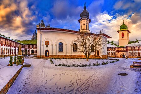 Agapia orthodox church monastery in winter season, Agapia town, Moldavia, Romania