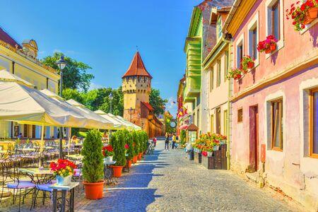 Little square and The Carpenters' Tower in Sibiu city, Transylvania region, Romania.