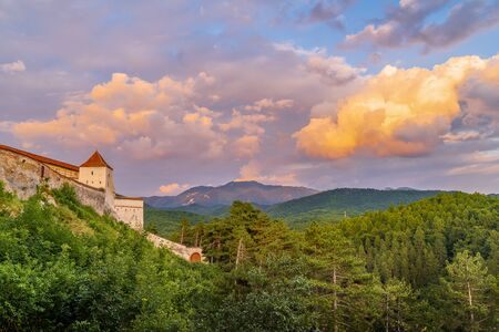 Landscape with Medieval fortress Rasnov at sunset, Brasov region, Transylvania, Romania