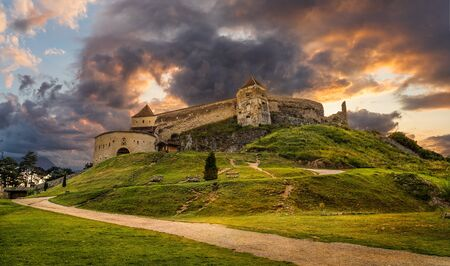 Landscape with Medieval fortress Rasnov at sunset, Brasov, Transylvania, Romania