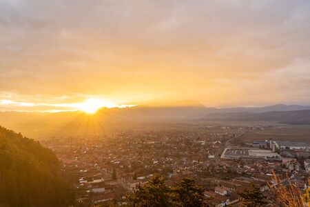 Landscape with aerial view of Rasnov town at sunset, Brasov, Transylvania, Romania