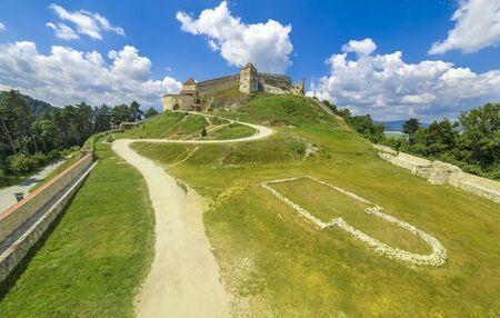 Medieval fortress (citadel) in Rasnov city, Brasov, Transylvania, Romania Stock Photo