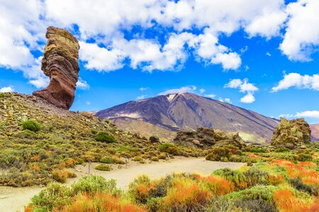 View of  Roques de Garcia formation and Teide mountain volcano in Teide National Park, Tenerife, Canary Islands, Spain.