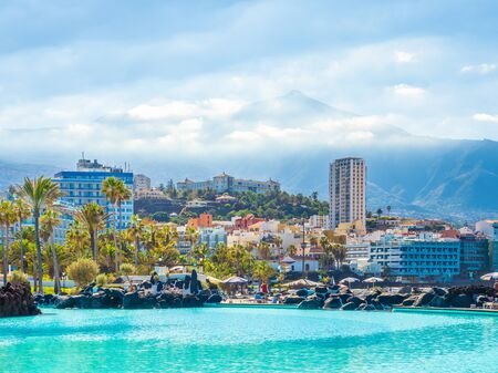 Puerto de la Cruz, Tenerife - 10 January, 2019: Landscape with Puerto de la Cruz, in background Teide volcano, Tenerife island, Spain Archivio Fotografico