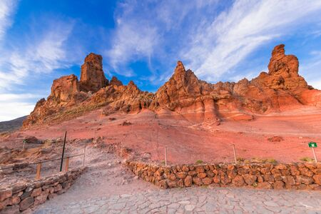 Volcanic mountain Teide with stone formation roques de garcia at sunset light in Teide National Park, Tenerife, Canary Islands, Spain.