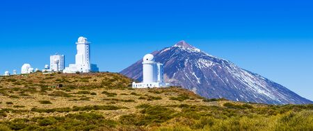 Telescopes of the Izana astronomical observatory on Teide park and Teide Volcano in winter season, Tenerife, Canary Islands, Spain